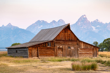 old barn in tetons flat sky sunrise