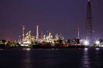 Oil refinery industry plant at night.