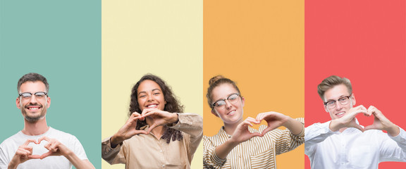Collage of a group of people isolated over colorful background smiling in love showing heart symbol and shape with hands. Romantic concept.