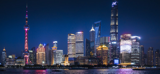 Shanghai, China :Nightscape of Lujiazui skyline as seen from the Bund, across the Huangpu River, with the Shanghai Tower.
