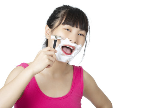 Chinese woman  shaving isolated on a white background
