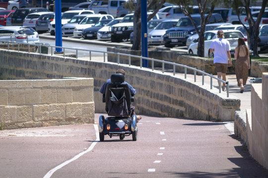 wheelchair going down the path