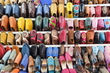Colorful Moroccan shoes at Marrakech souk market, Morocco.