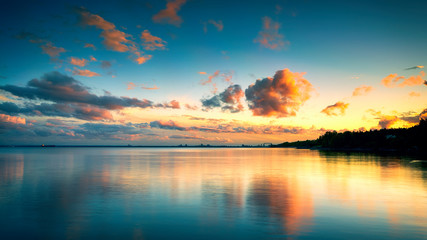 Dreamy Sunset with Clouds over Lake Superior Horizon