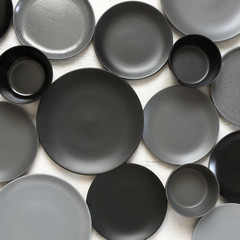 Monochrome tableware on white wood