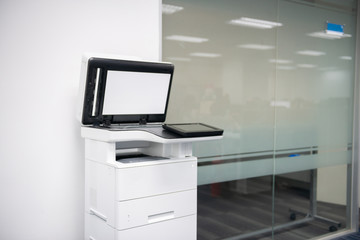 White modern laser multi function printer in the office location