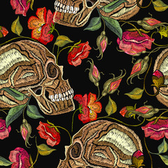 Embroidery skull and flowers seamless pattern. Fashion template for clothes, textiles, t-shirt design. Gothic romantic art. Human skulls red roses and peonies pattern