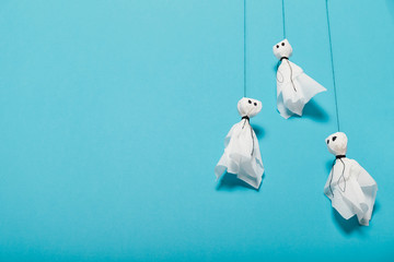 Spooky halloween celebration. Decor paper ghosts. Copy space for text. Wall mural