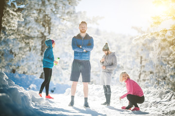 Sportspeople on snowy mountain
