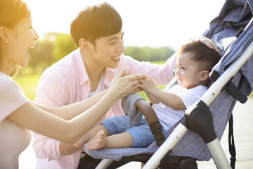 happy family with baby in the park