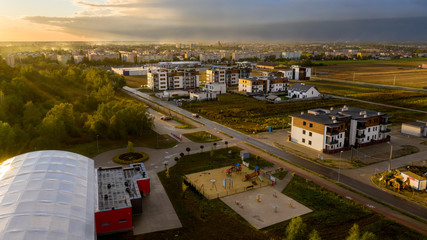 View from above on real estates in Ostrow Wielkopolski in Poland, during dynamic weather.