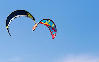 Kiteboarding. Kites flying in the sky.