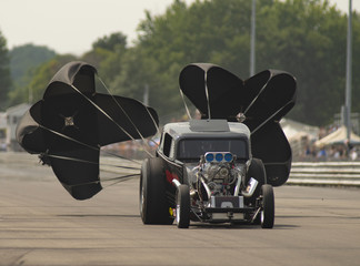 Dragster Deploys Chutes after Racing Run at the Drag Strip