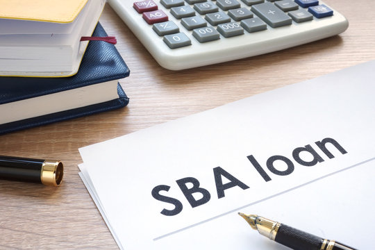 SBA loan form on an office table.