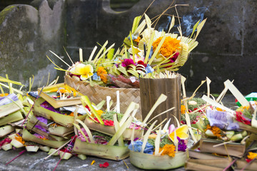 Hindu Balinese offerings to the gods consisting of woven baskets containing food and flowers.