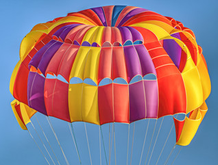 Foto op Aluminium Luchtsport Flying colorful, beautiful parachute in the air.