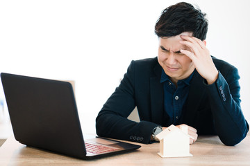 Asia Businessman Stress from work Investment in real estate, construction problems. Can not be completed as agreed. There are financial problems with installments with the bank.
