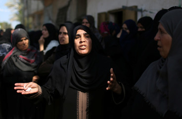 Mourners react during the funeral of Palestinian boy Nassir al-Mosabeh, 12, in Khan Younis in the southern Gaza Strip
