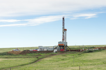 Drilling tower in the steppe. Steppe landscape with drilling rigs and equipment