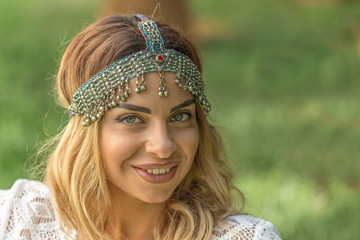 Boho chic. Beautiful woman wearing vintage headpiece.