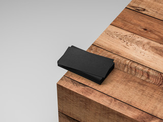Set of black blank business cards mockup on wooden table