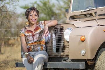 African woman and vintage Land Rover