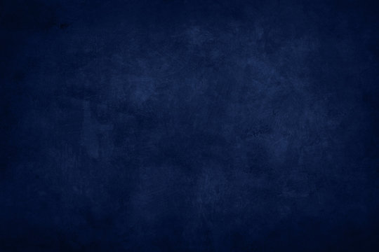 dark blue stained grungy background or texture