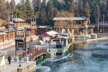 Frozen river through an ancient village of the Summer Palace park in  Beijing, China