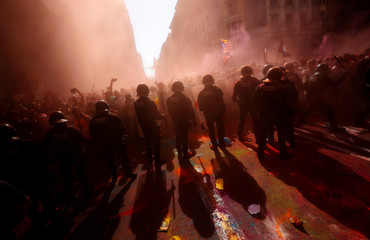 Catalan separatist protesters clash with Mossos d'Esquadra police officers in Barcelona