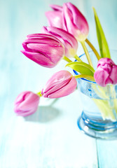 Pink Tulips. Flower background. Wooden background. Close up. Copy space.
