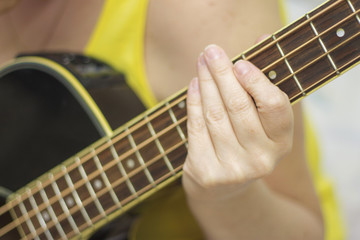 Woman holding an acoustic bass guitar