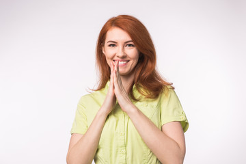 Beautiful young woman with red hair on white background