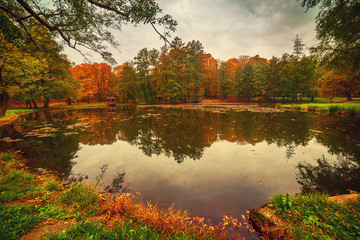 Beautiful autumn landscape with reflection in the lake, seasonal background
