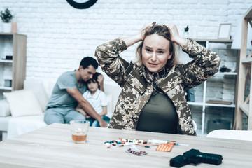 Sad Woman Taking Pills. Depression After War.