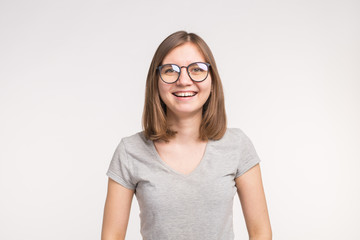 Young beautiful funny woman in glasses over white background