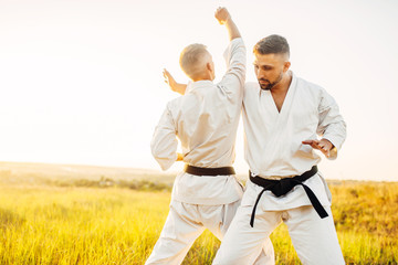 Two karate fighters, training fight in action