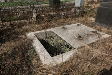 Cemetery with open grave, grave robbery