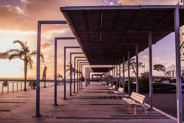 Perfect perspective in the sunset of a tunnel bench city