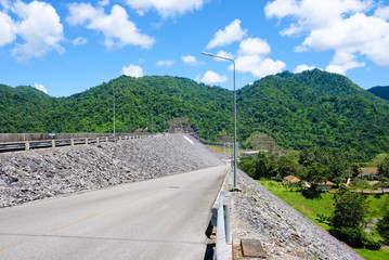 Travel through the mountain road on Khao Laem Dam in Thailand. The idea of finding a destination without knowing the route.