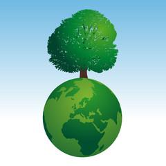 Concept de l'environnement avec le symbole écologique d'une terre verte sur laquelle pousse un arbre en feuille.