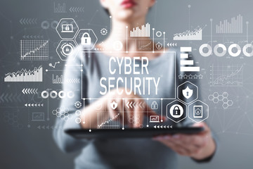 Cyber security with business woman using a tablet computer