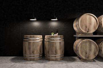 Black wine cellar, rows of kegs and bottle