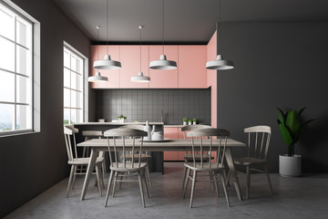 Gray tile kitchen with pink countertops, table