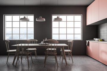 Wooden table in gray tile kitchen interior