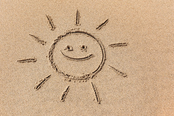 Drawing of the sun on the sand