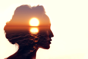 Psychology concept. Sunrise and woman silhouette. Wall mural
