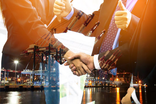 Business collaboration shake hands and abstract blur transportation import export background