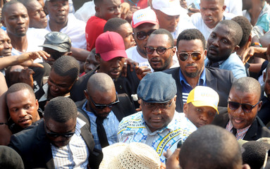 Felix Tshisekedi (C), leader of Congolese main opposition the Union for Democracy and Social Progress (UDPS) party is welcomed by his supporters as he arrives for a joint rally in Kinshasa