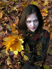 conceptual portrait of young attractive woman in the autumn park