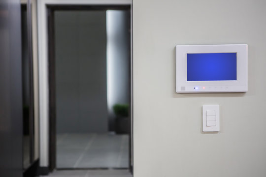Home interior with a smart home control console or air conditioning setting - remote control touch screen